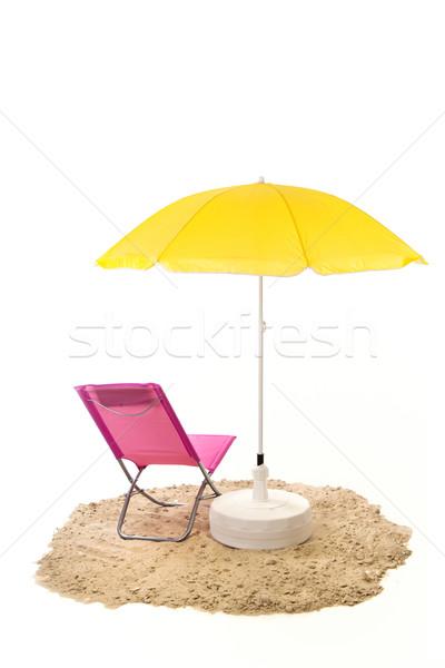 Nyugalmas tengerpart rózsaszín szék citromsárga napernyő Stock fotó © ivonnewierink