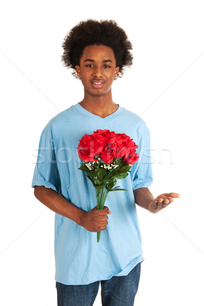 Black Teen Boy Is Giving Flowers Stock Photo C Ivonnewierink 2456037 Stockfresh