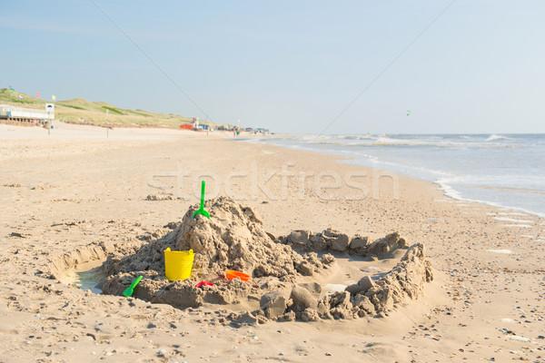 Homokvár tengerparti homok kastély észak tenger tengerpart Stock fotó © ivonnewierink