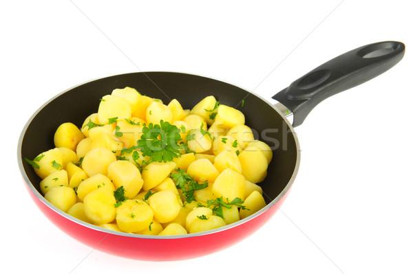 Red frying pan new potatoes Stock photo © ivonnewierink