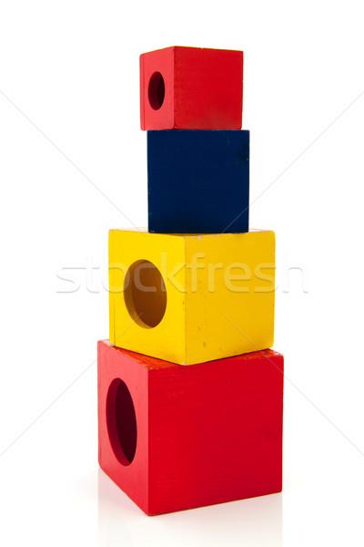 Fa játék kockák egymásra pakolva izolált fehér kék Stock fotó © ivonnewierink