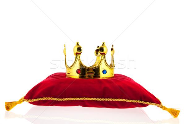Altın taç kadife yastık kırmızı arka plan Stok fotoğraf © ivonnewierink