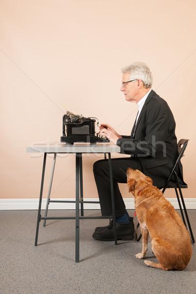 Senior man with antique typewriter Stock photo © ivonnewierink
