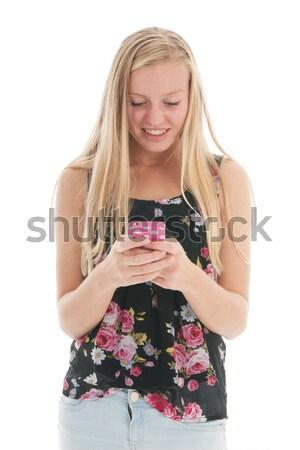 Teenager with smartphone Stock photo © ivonnewierink
