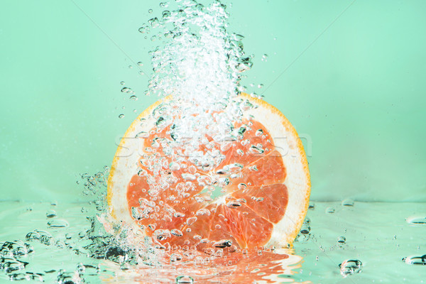Fresh grapefruit splash Stock photo © ivonnewierink