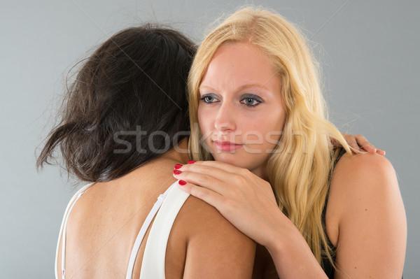 Mulher reconfortante amigo triste isolado cinza Foto stock © ivonnewierink
