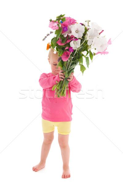 Dziewczyna kwiaty portret bukiet ogród Zdjęcia stock © ivonnewierink