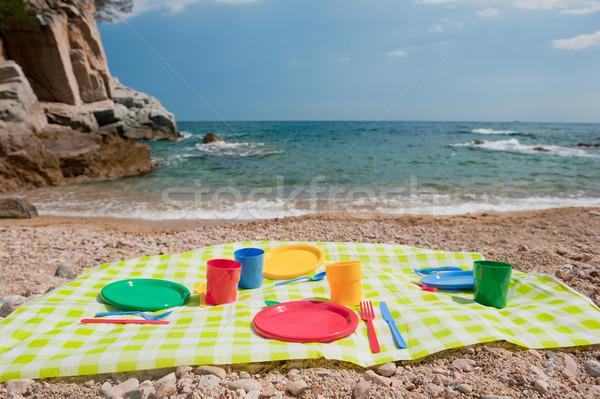 Picknick strand kleurrijk plastic water zomer Stockfoto © ivonnewierink