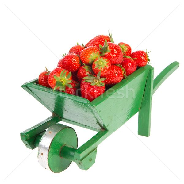 Wheelbarrow with strawberries Stock photo © ivonnewierink