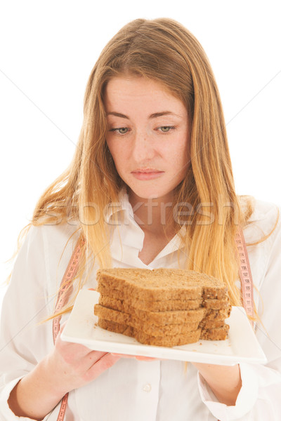 Woman doubting about fresh brown bread for diet Stock photo © ivonnewierink