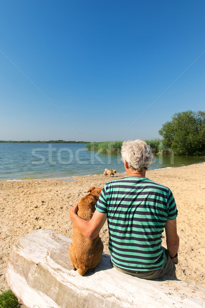 Man with dog in landscape with river Stock photo © ivonnewierink