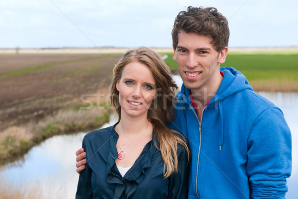 Young couple in Dutch landscape Stock photo © ivonnewierink