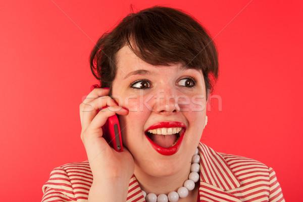 Bonnes nouvelles smartphone jeune femme affaires femme téléphone Photo stock © ivonnewierink