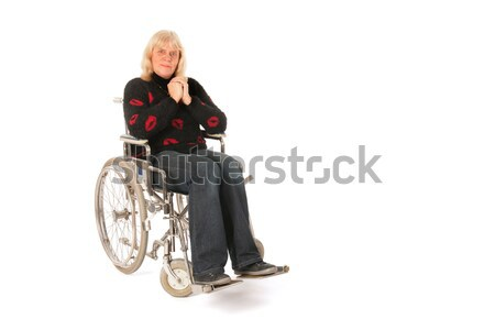 Mulher madura roda cadeira cadeira de rodas isolado branco Foto stock © ivonnewierink