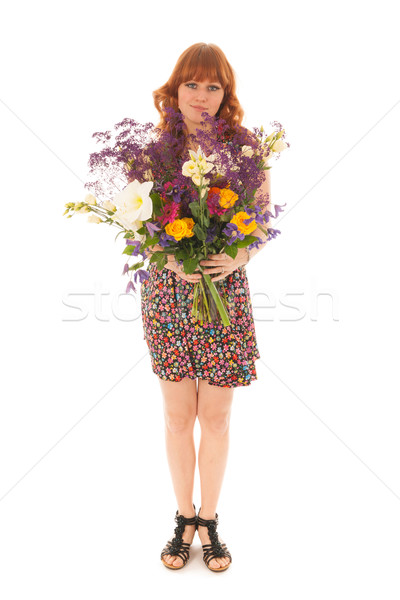 Red haired girl standing with bouquet flowers isolated over whit Stock photo © ivonnewierink