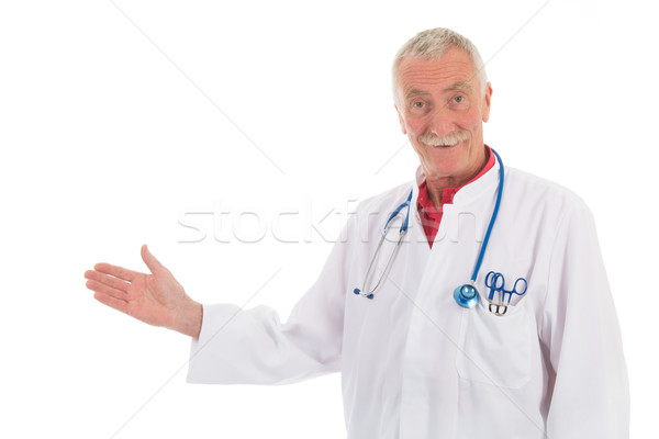 Physician presenting something on white background Stock photo © ivonnewierink