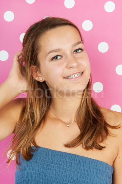 teen girl portrait on pink Stock photo © ivonnewierink
