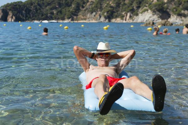 Aposentados homem jogar mar água inflável Foto stock © ivonnewierink