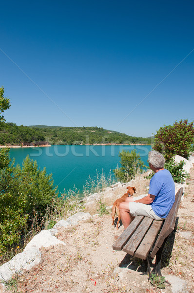 man with dog sitting in French landscape Stock photo © ivonnewierink