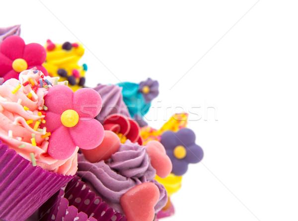 Lila rózsaszín minitorták sarok vajkrém virágok Stock fotó © ivonnewierink