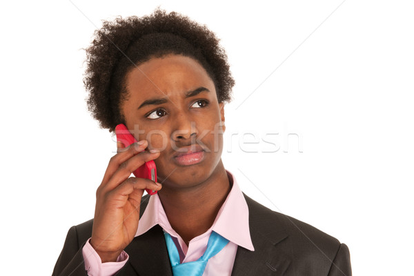 Black business man with mobile phone Stock photo © ivonnewierink