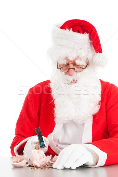 Santa breaking his piggy bank Stock photo © ivonnewierink