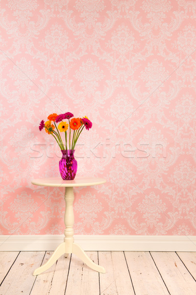 Vintage wall and wooden floor with vase flowers on table Stock photo © ivonnewierink