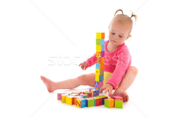 Stock photo: Toddler girl playing with blocks