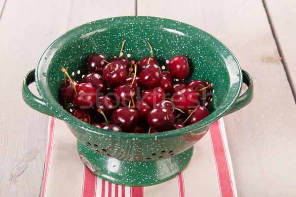 Fresh cherries in colander Stock photo © ivonnewierink