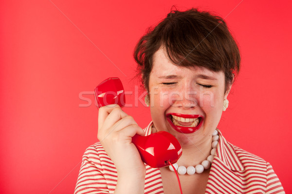 Stock photo: Crying on the phone