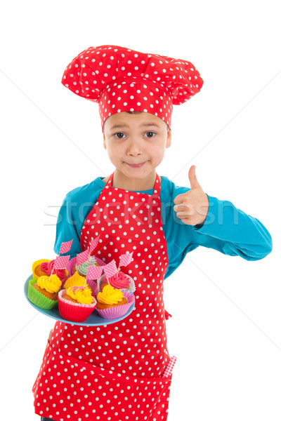Studio portrait boy as little cook with cupcakes Stock photo © ivonnewierink