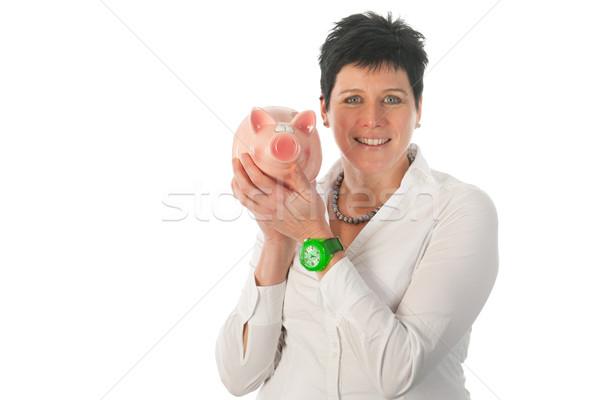 Woman is holding piggy bank Stock photo © ivonnewierink