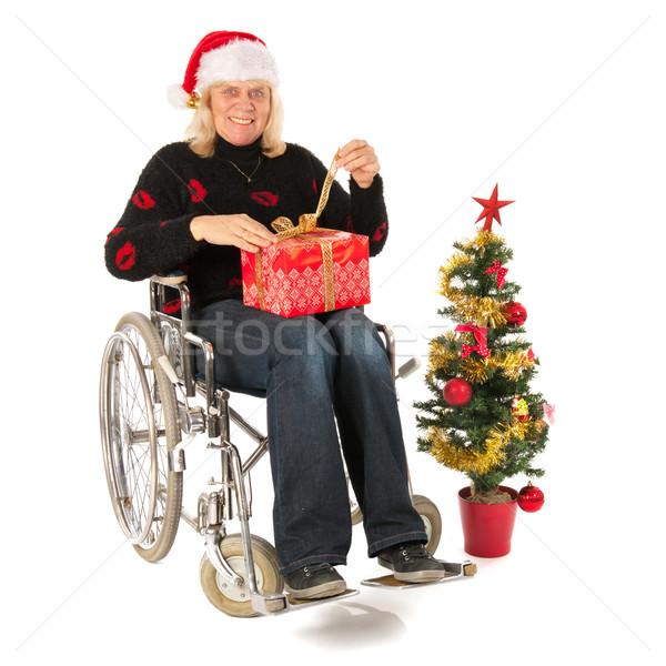 Mulher madura roda cadeira natal tempo presentes Foto stock © ivonnewierink