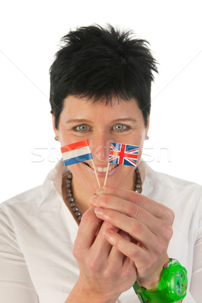 Stock photo: Young woman with English Dutch flags