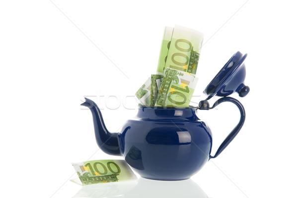 Blue enamel tea pot with money Stock photo © ivonnewierink