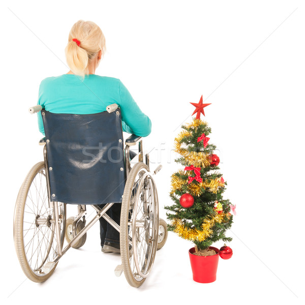 Stock photo: Blond woman in wheel chair while Christmas