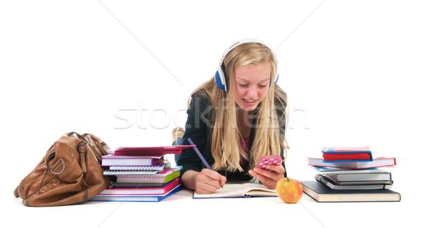 Tienermeisje huiswerk afleiding mobiele telefoon school Stockfoto © ivonnewierink