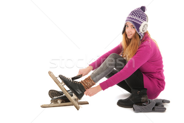 Attractive woman put on the ice skates Stock photo © ivonnewierink