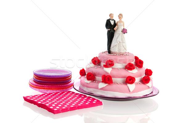 Pár felső esküvői torta rózsaszín vörös rózsák izolált Stock fotó © ivonnewierink