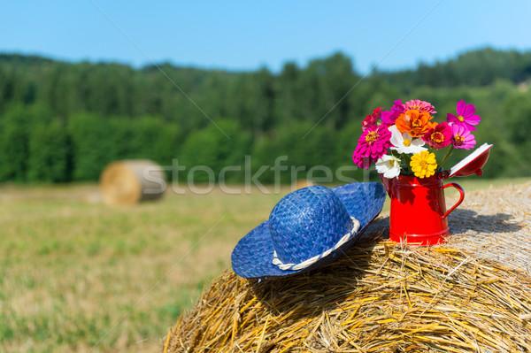 Bouquet flowers and summer hat in summer Stock photo © ivonnewierink
