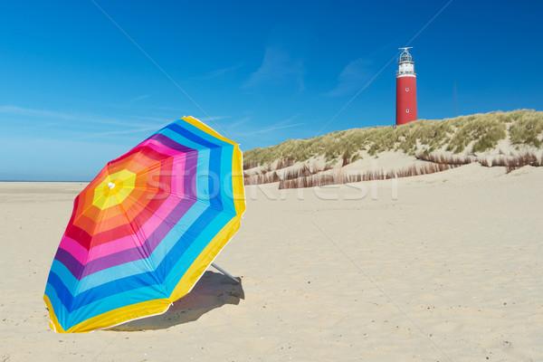 Vuurtoren nederlands eiland kleurrijk parasol strand Stockfoto © ivonnewierink