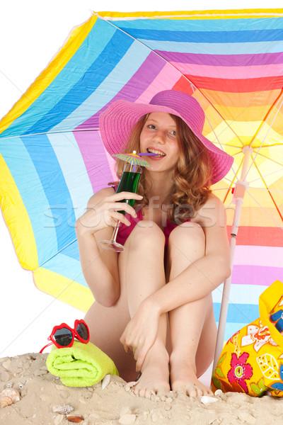 Stok fotoğraf: Güneşlenme · plaj · renkli · güneş · şemsiyesi · kadın · oturma