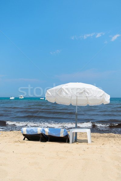 Stock photo: Beach with parasols and beds