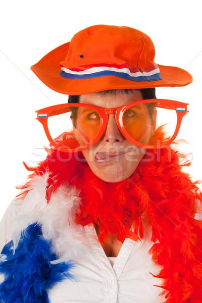 Dutch woman in orange as soccer fan Stock photo © ivonnewierink