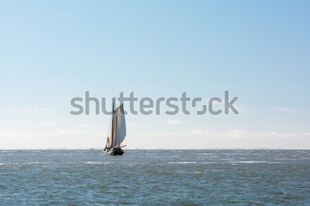 Old Dutch sailboat at sea Stock photo © ivonnewierink