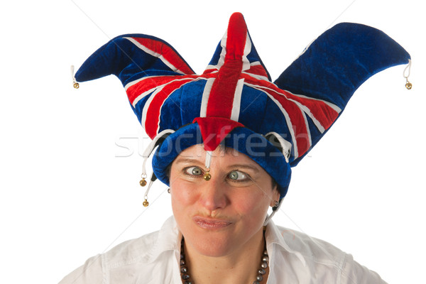 Woman with cross eyes to Brittain funny hat Stock photo © ivonnewierink
