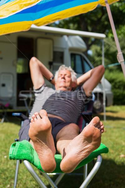 Kemping starszych człowiek snem bose stopy Zdjęcia stock © ivonnewierink