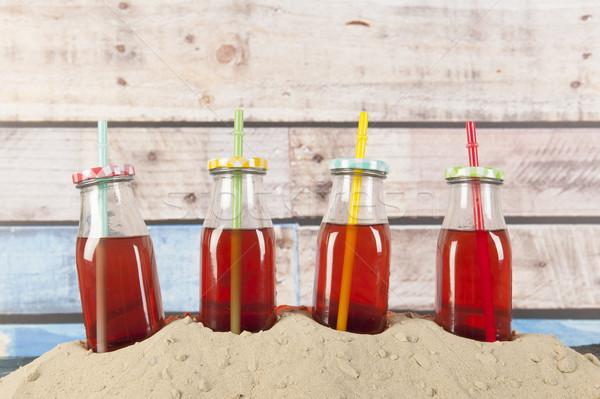 Bottles lemonade at the beach Stock photo © ivonnewierink