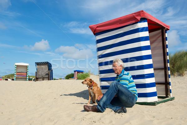 Man with dog at beach Borkum Stock photo © ivonnewierink
