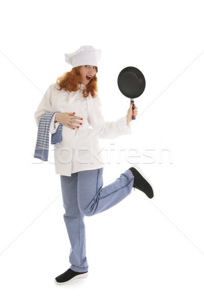 Femeie găti bucătar-şef tigaie Dansuri Imagine de stoc © ivonnewierink
